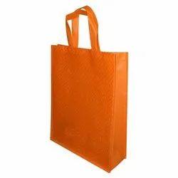 Loop Handle Plain Orange Non Woven Shopping Bag, Capacity: 2kg