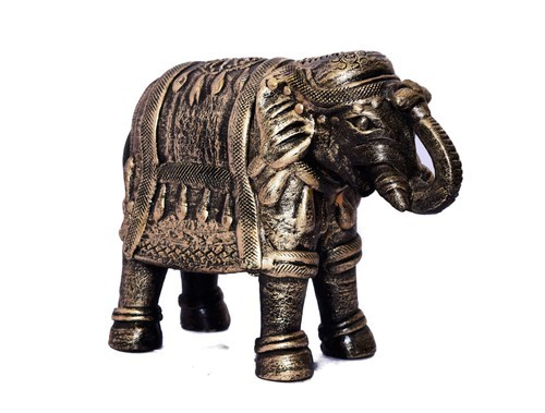 golden and black or mixed or mixed of white and black clay elephant