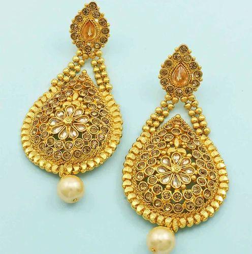 0386ae57286 Orniza Golden Beige Polki Stones Dangle Earrings