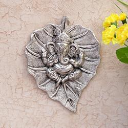 Metal Ganesha Carved on a Leaf