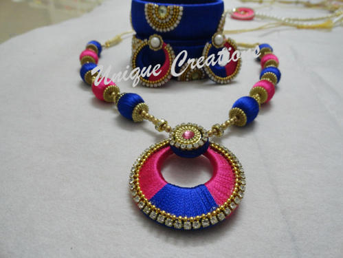 red bangles with necklace and thread jhumkas silk set matching