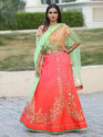 Mahima Orange Green Embroidered Stitched Lehenga With Net Dupatta
