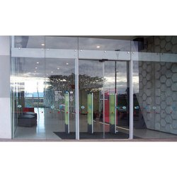 Grey Glass Synchro Bi-Parting Doors System, For Office, Size/Dimension: 1100 Mm (w) X 3000 Mm (h)