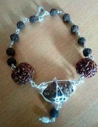 1 Mukhi, 6 mukhi, 7 mukhi rudraksha with silver cap bracelet