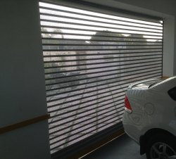 Perforated rolling shutter with automation