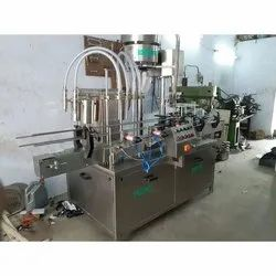 Syrup Bottle Filling & Sealing Machine