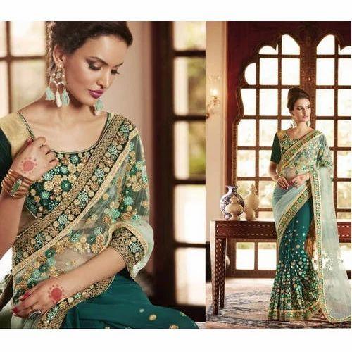 21b637211243e8 Net Wedding Wear Saree With Blouse Piece