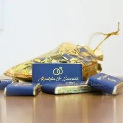 Customized Potlis / Pouches of Assorted Chocolates for Wedding Gifting