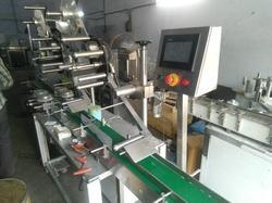 Spray Pockets Labeling Machine