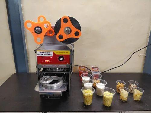 GLASS PACKING MACHINE - Rotary Cup Sealing Machine
