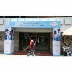 Holding Advertisement Banner