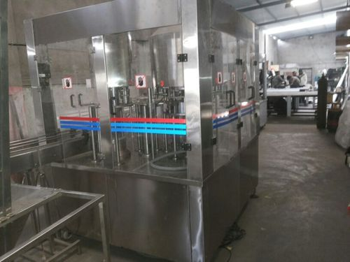 Rinsing, Filling & Capping Machine - Bottle Filling Machines