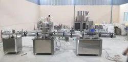 Automatic Four Head Volumetric Liquid Filling Machine