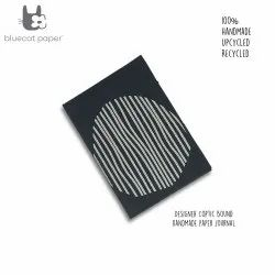 Upgrade your desk essentials with this A6 Coptic bound grey journal - off-white lines circle