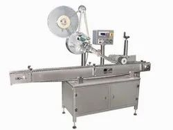 Automatic Horizontal & Top Labeling Machine.