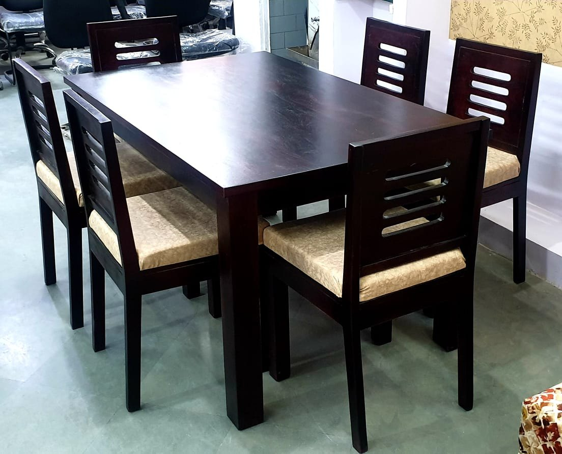 dark brown wooden 6 seater dining table for home size