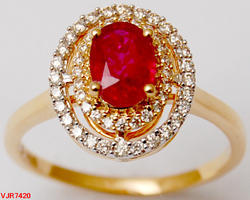 Occasion Wear Oval Shaped Ring With Studded Ruby And Halo Diamonds