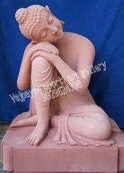 Red Stone Buddha Statue