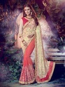 Cream and Orange Georgette Saree
