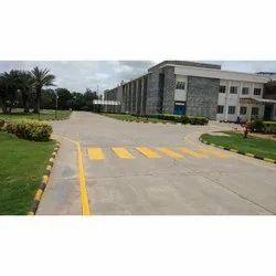 Yellow Road Marking Service on Concrete Surface