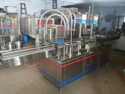 Liquor Bottle Filling Machine