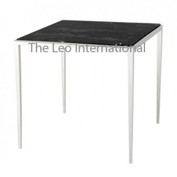 stainless steel table with black granite top