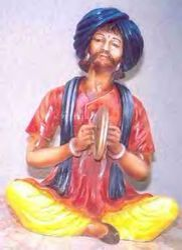 Man Playing Harmonium Statues