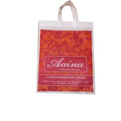 White and Red Printed Non Woven Loop Handle Carry Bag, Capacity: 2 - 7 Kg