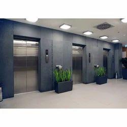 Spire Glass and Wood Machine Roomless Elevators