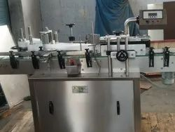 AUTOMATIC GLASS BOTTLE LABELING MACHINE