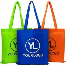 Printed Loop Handle Non Woven Carry Bag, Capacity: 5-15 Kg