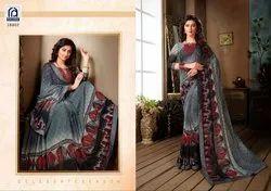 Rachna Georgette Saffron Catalog Saree Set For Woman 7