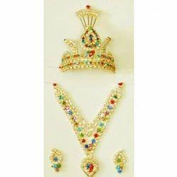Pushti Multicolor Brass Laddu Gopal Jewellery Set