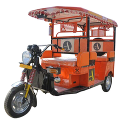 Orange Electric Rickshaw