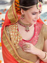 Orange And Beige Embroidered Saree