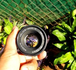 Nikon Mount 20mm F2 8 manual focus lens and Olympus 50mm F1