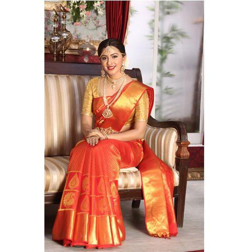 Orange And Golden Bridal Silk Saree