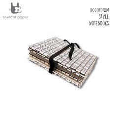 White Accordion Style Notebook With Black Lines Bricks