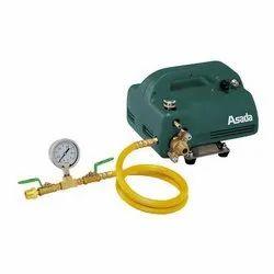 Compact pressure testing pump