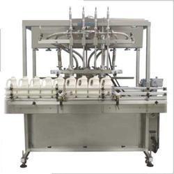 Servo Based Automatic Four Head Filling Machine