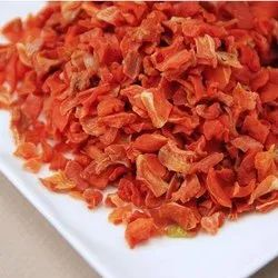 Dried Carrot cubes or flakes.