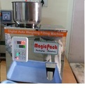 Particle Weighing And Filling Machine