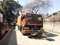 Sweeper Truck In Industrial Road