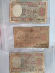 2 Rupees Note With Different Governors Signatures And Has a Satalite Behind It