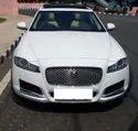 By Road Sedan Jaguar Car Rental Service
