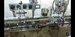 Peristaltic Pump Based Automatic Filling And Capping Machine
