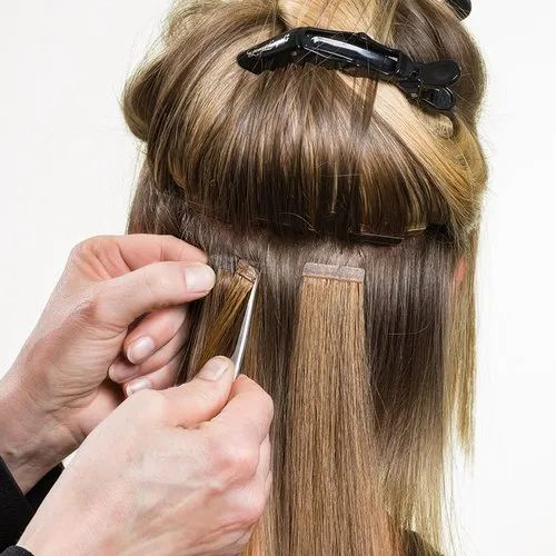 Tape in hair extensions installation