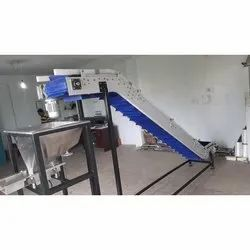 Auto Filling Inclined Cleated Modular Belt Conveyor