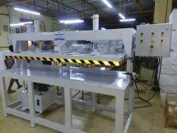 Hydraulic pack sealing & pressing machine.