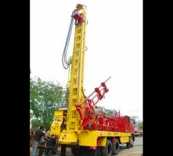 Drilling Rig with Auto Rod Loader